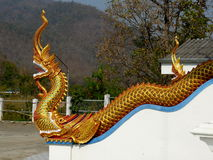 Golden Dragon. A Golden Dragon basking in the sun at a Wat in Northern Thailand Stock Photo
