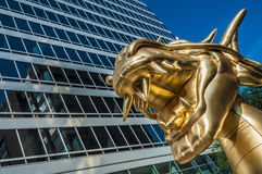 Golden dragon and building Stock Photography