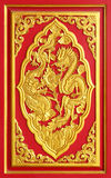 Golden dragon carved from wood Royalty Free Stock Image