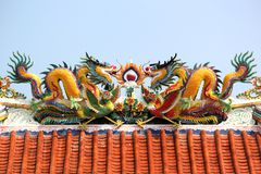 Golden dragon in chinese shrine. With beautiful sky background royalty free stock images