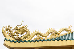 Golden dragon on the chinese temple roof Royalty Free Stock Images