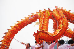Golden dragon dance Stock Photo
