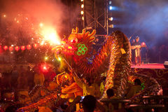 Golden dragon dancing in Chinese New Year. Royalty Free Stock Images