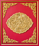 Golden Dragon Decorated On Red Wood Stock Photos