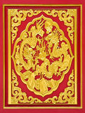 Golden dragon decorated on red wood Royalty Free Stock Images