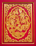 Golden dragon decorated on red wood stock photography