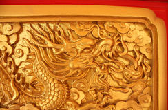 Golden dragon decorated on red wood wall Stock Photo