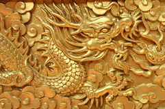 Golden dragon decorated on red wood wall Royalty Free Stock Photography