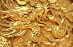 Golden dragon decorated on red wood wall Royalty Free Stock Images
