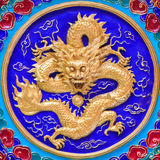 Golden dragon on  wall Royalty Free Stock Photo