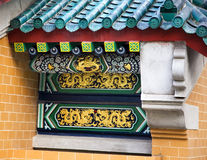 Golden dragon detail under roof Stock Images