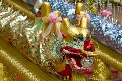 The golden dragon head decorated beautifully. Golden dragon head decorated for the festival on the handle rail Stock Photography