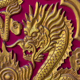 Golden Dragon Head on Red wood door Royalty Free Stock Photography