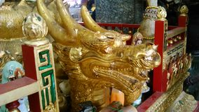 Golden Powerful Dragon head sculpture  in the temple Royalty Free Stock Image