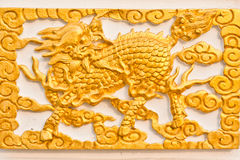 Golden dragon-headed unicorn Stock Image