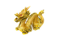 Golden dragon isolated on white background. Golden traditional chinese dragon isolated on white background. Feng Shui statuette Stock Photography