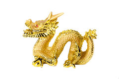 Golden dragon isolated on white background. Golden traditional chinese dragon isolated on white background. Feng Shui statuette Royalty Free Stock Photography