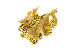 Golden dragon isolated on white background. Golden traditional chinese dragon isolated on white background. Feng Shui statuette Royalty Free Stock Photo