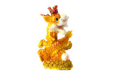 Golden dragon isolated on white background. Golden traditional chinese dragon isolated on white background. Feng Shui statuette Stock Photo