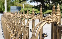 Golden Dragon Pattern guardrail. Golden DragonBall Pattern guardrail Used in front of the gate Royalty Free Stock Photography