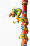 Golden dragon. The golden dragon at the red pole Royalty Free Stock Image