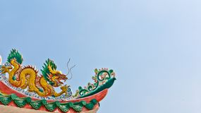 Golden dragon on the roof Stock Images