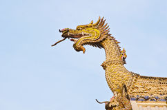 Golden dragon  on the roof in temple of Thailand. Royalty Free Stock Images