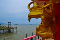 Golden dragon sculpture in the chinese temple. Koh Lanta, Thailand. Stock Photos