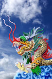 Golden dragon statue in  blue sky Stock Images