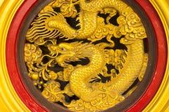 Golden dragon statue in temple Stock Photos
