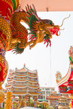 Golden dragon statue on pillar Stock Photos