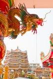 Golden dragon statue on pillar Stock Photos