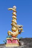 Golden dragon statue on pillar on the stone Royalty Free Stock Photos