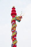 Golden dragon statue on pole in the Chinese temple in Thailand. Royalty Free Stock Photo