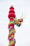 Golden dragon statue on pole in the Chinese temple in Thailand. Stock Images