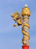 Golden dragon statue on pole Stock Photography