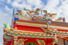Golden dragon statue on public shrine roof, Thailand, Dragon prominently in the beautiful. On blue sky background stock photos