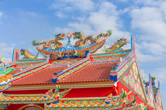 Golden dragon statue on public shrine roof, Thailand. Dragon prominently in the beautiful on blue sky background royalty free stock photos