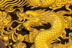 Golden dragon statue in temple Royalty Free Stock Photos