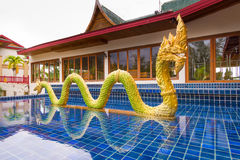Golden dragon statue in Thailand royalty free stock photography
