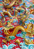 The golden dragon statue on wall at chinese temple Royalty Free Stock Photos