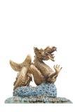 Golden Dragon statue. On white bachground Stock Photo