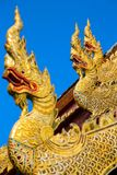 Golden dragon statues on the roof of buddhist temple Royalty Free Stock Photos