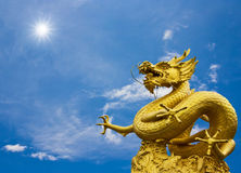 Golden dragon staute. Golden dragon statue again blue sky Royalty Free Stock Photo