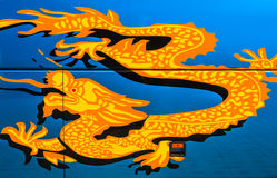 Golden Dragon Sticker. On Side of Touring Bus Stock Image