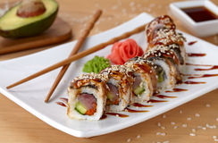 Golden dragon sushi roll with tuna, eel, cucumber Stock Photo