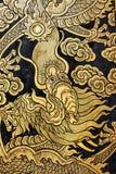 Golden dragon, Thai pattern art at Wat Nang Chee Chotikaram. Royalty Free Stock Photos