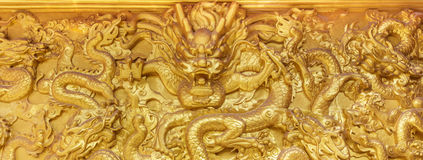 Golden dragon wall. Chinese golden dragon wall at a public shrine Stock Photography