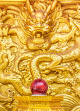 Golden dragon wall. Chinese golden dragon wall at a public shrine Stock Photos