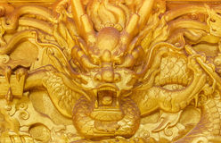 Golden dragon wall. Chinese golden dragon wall at a public shrine Royalty Free Stock Photography
